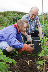 People with learning disability working on allotment