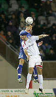 Photo: Marc Atkins.<br /> Milton Keynes Dons v Farsley Celtic. The FA Cup. 21/11/2006. James Knowles (T) of Farsley Celtic in action with Paul Mitchell of MK Dons.