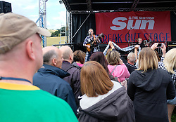 "Party at the Palace, Linlithgow, Saturday 12th August 2017<br /> <br /> Stuart ""Woody"" Wood from the Bay City Rollers performs with his new band Woody's Rollercoasters on the Break Out Stage. His performance attracted some old Rollers fans to the stage.<br /> <br /> (c) Alex Todd 