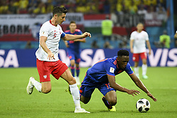 June 25, 2018 - Kazan, Russia - Robert Lewandowski of Poland and Yerry Mina of Colombia during the 2018 FIFA World Cup Group H match between Poland and Colombia at Kazan Arena in Kazan, Russia on June 24, 2018  (Credit Image: © Andrew Surma/NurPhoto via ZUMA Press)