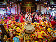 16 FEBRUARY 2018 - BANGKOK, THAILAND: People make offerings and pray at Wat Mangkon Kamalawat during Chinese New Year celebrations in the Chinatown neighborhood of Bangkok. Thailand has a large Chinese community and Lunar New Year is widely celebrated, especially in larger cities. This will be the Year of the Dog.      PHOTO BY JACK KURTZ