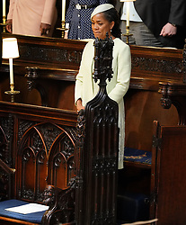 Doria Ragland takes her seat in St George's Chapel at Windsor Castle ahead of the wedding of her daughter Meghan Markle to Prince Harry.