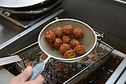 Deep frying Falafel balls (Small croquette of mashed chickpeas)