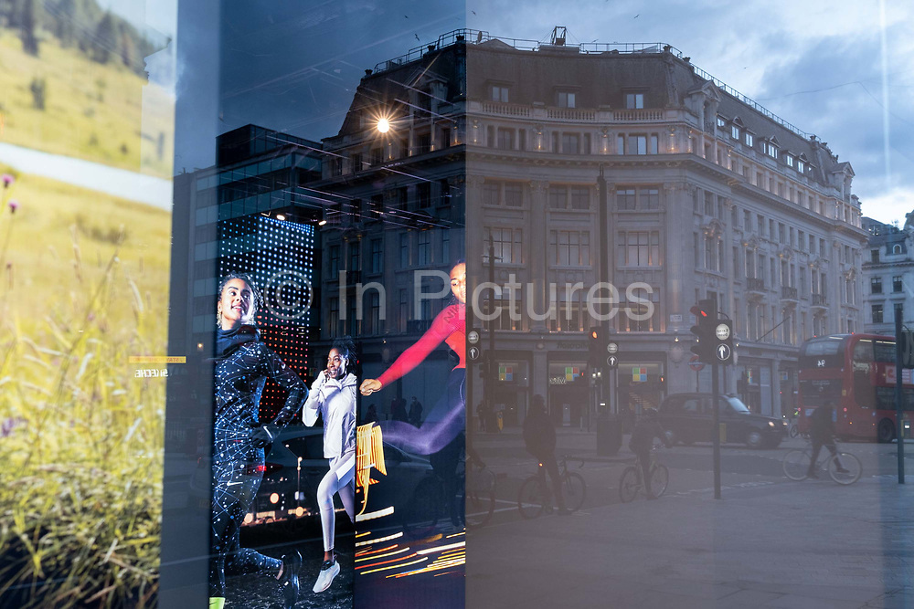 Young woman are seen in an ad in the window of the Oxford Circus branch of NikeTown, during the third lockdown of the Coronavirus pandemic, on 5th February 2021, in London, England.