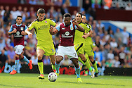 Adama of Aston Villa ® , holds off Dominic Ball of Rotherham Utd. .EFL Skybet championship match, Aston Villa v Rotherham Utd at Villa Park in Birmingham, The Midlands on Saturday 13th August 2016.<br /> pic by Andrew Orchard, Andrew Orchard sports photography.