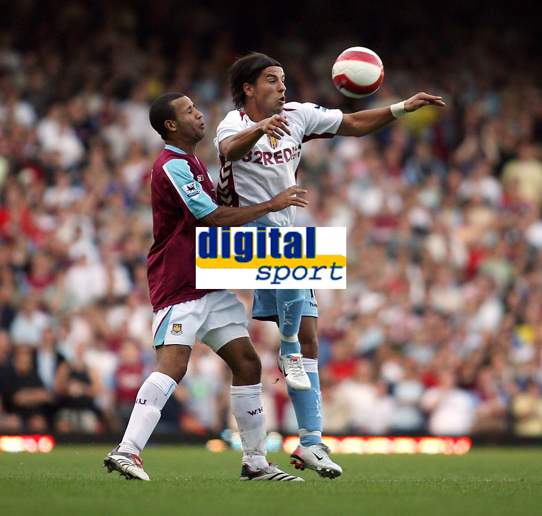 Photo: Chris Ratcliffe.<br /> West Ham United v Aston Villa. The Barclays Premiership. 10/09/2006.<br /> Juan Pablo Angel of Aston Villa clashes with Tyrone Mears of West Ham.