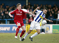 Photo: Chris Ratcliffe.<br />Colchester United v Southend United. Coca Cola League 1. 04/03/2006.<br />Freddie Eastwood (L) of Southend tussles with Karl Deguid of Colchester.