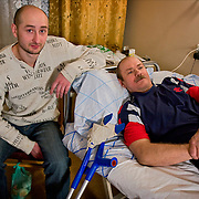 Portrait of Chechnya war veteran writer Arkady Babchenko with one of the veterans mentioned in his book at a hospital in Moscow, Russia.