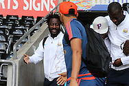 Swansea city player Jefferson Montero greets Wilfried Bony of Manchester city (l) as they arrive at the stadium before the match. Barclays Premier league match, Swansea city v Manchester city at the Liberty Stadium in Swansea, South Wales on Sunday 15th May 2016.<br /> pic by Andrew Orchard, Andrew Orchard sports photography.