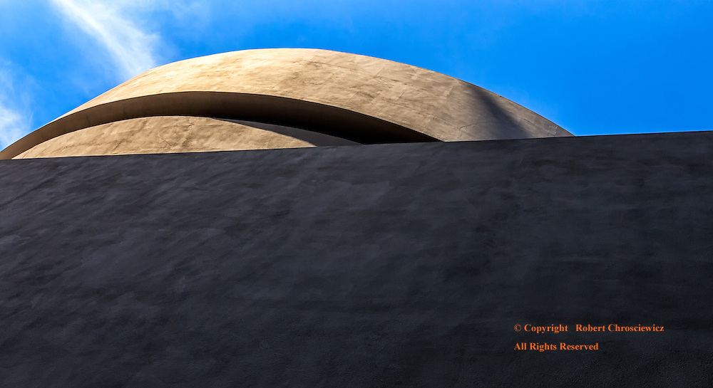 Geometric Museum: An oblique view of the Guggenheim Museum of Modern Art, with the rectangular lower aspect of the building set against the circular top, New York, New York USA.