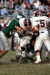 10 November 2007: Andrew Hershey gets squished between Thunders Jeremy Wenger and defender Charlie Welke and almost looses the ball. This game between the Wheaton College Thunder and the Illinois Wesleyan University Titans was for a share of the CCIW Championship and was played at Wilder Field on the campus of Illinois Wesleyan University in Bloomington Illinois.