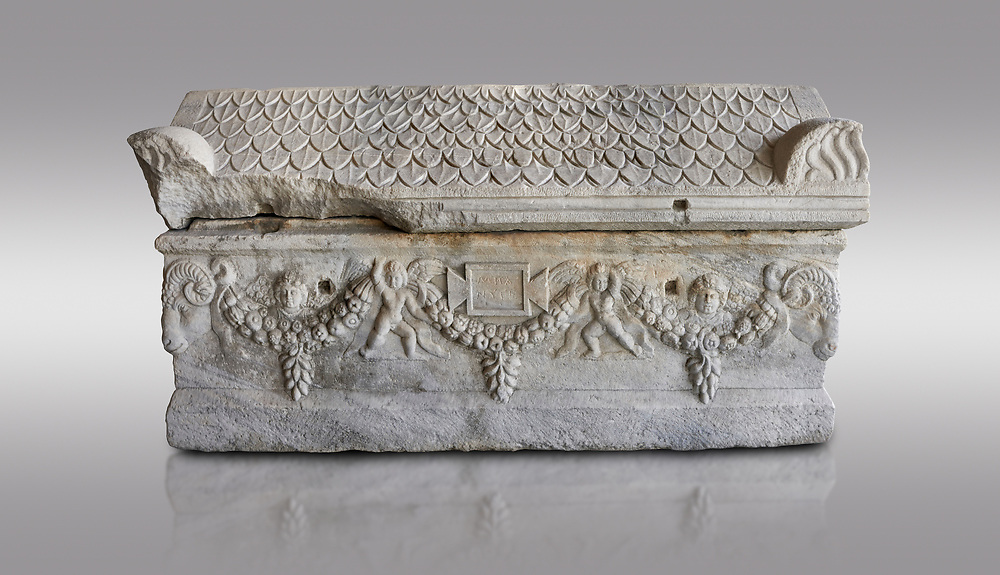 Roman relief sculpted garland sarcophagus with pitched tile sculpted roof, 3rd century AD. Adana Archaeology Museum, Turkey. Against a grey background .<br /> <br /> If you prefer to buy from our ALAMY STOCK LIBRARY page at https://www.alamy.com/portfolio/paul-williams-funkystock/greco-roman-sculptures.html . Type -    Adana     - into LOWER SEARCH WITHIN GALLERY box - Refine search by adding a subject, place, background colour, museum etc.<br /> <br /> Visit our ROMAN WORLD PHOTO COLLECTIONS for more photos to download or buy as wall art prints https://funkystock.photoshelter.com/gallery-collection/The-Romans-Art-Artefacts-Antiquities-Historic-Sites-Pictures-Images/C0000r2uLJJo9_s0