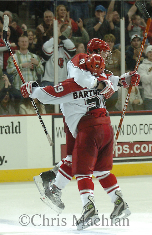 University of Nebraska at Omaha's Juha Uotila jumps into the arms  Adam Bartholomay after scoring the winning goal late in the third period against fourth ranked Notre Dame.<br />