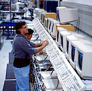 Product testing at the Dell Computer manufacturing plant in Austin, Texas.