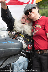 Dave Zien joking around with Cris Simmons in the staging area at Miller Park for the big parade downtown during the Harley-Davidson 115th Anniversary Celebration event. Here they are in the staging area at Miller Park, Milwaukee, WI. USA. Sunday September 2, 2018. Photography ©2018 Michael Lichter.
