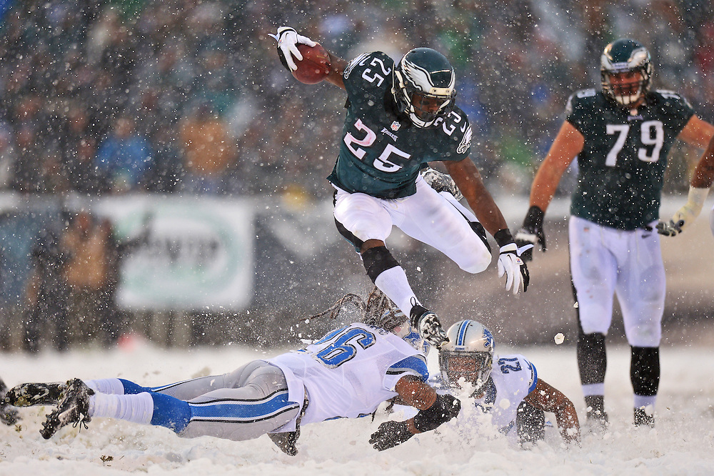 PHILADELPHIA, PA - DECEMBER 08: LeSean McCoy #25 of the Philadelphia Eagles jumps over Louis Delmas #26 of the Detroit Lions and runs for his first touchdown of the game at Lincoln Financial Field on December 8, 2013 in Philadelphia, Pennsylvania. The Eagles won 34-20. (Photo by Drew Hallowell/Philadelphia Eagles/Getty Images) *** Local Caption *** LeSean McCoy;Louis Delmas