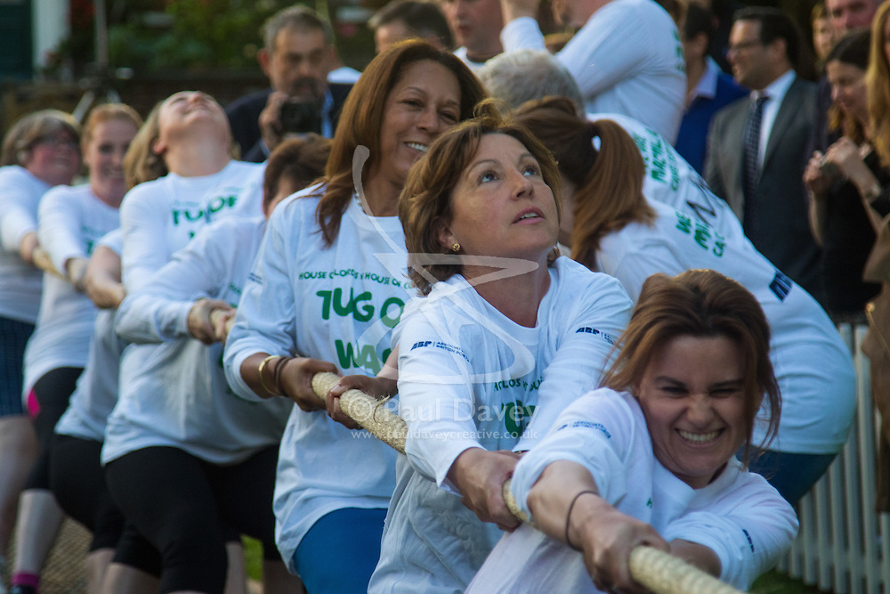 Westminster, London, June 6th 2016. Female MPs grimace as they pull against the McMillan women's team as teams from uk industry as well as the House of Commons and the House of Lords compete in the annual McMillan Cancer Charity tug o' war.