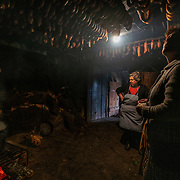 Women cook at an ancient kitchen in Covas do Barroso. Every year, in the beggning of the winter, residents slaughter pigs to make ham and sausages that feed them all through the year. The slaughter is a community event, with neighbors coming to help kill and dismember the animals and at the end treated to a large meal