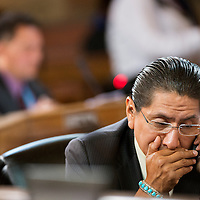 071713       Brian Leddy<br /> Jonathan Nez speaks on his cell phone during discussion on the lease renewal of the Navajo Generating Station.