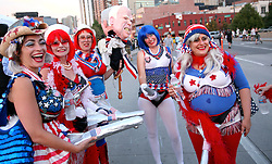 """A group of women outside the DNC dressed up as cartoonish patriotic girls """"from Crawford, Texas."""""""