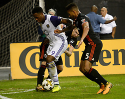 September 9, 2017 - Washington, DC, USA - 20170909 - D.C. United midfielder RUSSELL CANOUSE (4), back, and D.C. United defender SEAN FRANKLIN (5) pinch down Orlando City FC forward CYLE LARIN (9) near a corner during the second half at RFK Stadium in Washington. (Credit Image: © Chuck Myers via ZUMA Wire)