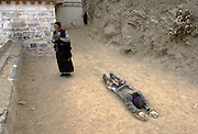 Devout pilgrims prostrate themselves thousands of times in their arduous quest for enlightenment. <br /> <br /> Each day during Losar (Tibetan New Year),thousands of pilgrims walk the kora around Labrang Monastery, the largest in Amdo Province, and indeed China.<br /> <br /> Established in 1709, Labrang housed over 4000 monks at its peak, but now only has around 1500 monks.