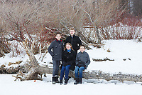 Winter outdoor family portraits in the snow at Edworthy Park in SW Calgary.<br /> <br /> ©2018, Sean Phillips<br /> http://www.RiverwoodPhotography.com