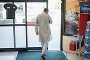 Gulab leaves the grocery store in Arlington, Texas on May 6, 2016. With respect to his religion, Gulab travels over 30 minutes to the closest store that caters to the muslim population