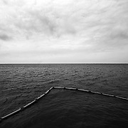 """A protective boom floats at the entrance to a marsh near Dauphin Island, Alabama, on 5.14.10. The region has been preparing for the growing oil spill in the Gulf of Mexico after the Deepwater Horizon disaster. ltqmb """"Lower the Boom"""""""