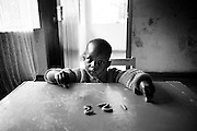 NAIROBI, KENYA - JANUARY 8, 2008: A boy practices his numbers in a Kenyan classroom on the first day schools re-opened following the post-election violence. A surge in violence left scores of people dead in Nairobi as defeated presidential candidate Odinga prepared to declare himself head of state, after rejecting the victory of incumbent president Mwai Kibaki.