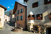 In the Engadine Valley the village of Guarda with old painted stone 17th Century buildings, Switzerland