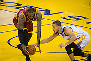 Golden State Warriors guard Stephen Curry (30) reaches for the ball against Cleveland Cavaliers forward LeBron James (23) at Oracle Arena in Oakland, Calif., on January 16, 2017. (Stan Olszewski/Special to S.F. Examiner)