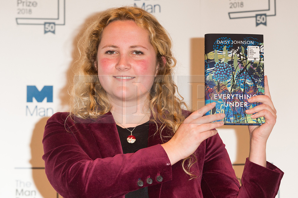 © Licensed to London News Pictures. 14/10/2018. London, UK. Author Daisy Johnson poses with her book Everything Under during a photocall at the Royal Festival Hall, two days ahead of the announcement of the winning book of the 2018 Man Booker Prize. Six novelists have been shortlisted for the 2018 Man Booker Prize, a literary prize awarded for the best original novel in English credit: PhotoRay Tang/LNP