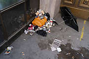 While office workers remain at home in accordance to government Covid guidelines and individual corporate policies, litter has blown towards the entrance of a closed business in the City of London, the capitals financial district, during the third lockdown of the Coronavirus pandemic, on 9th March 2021, in London, England.