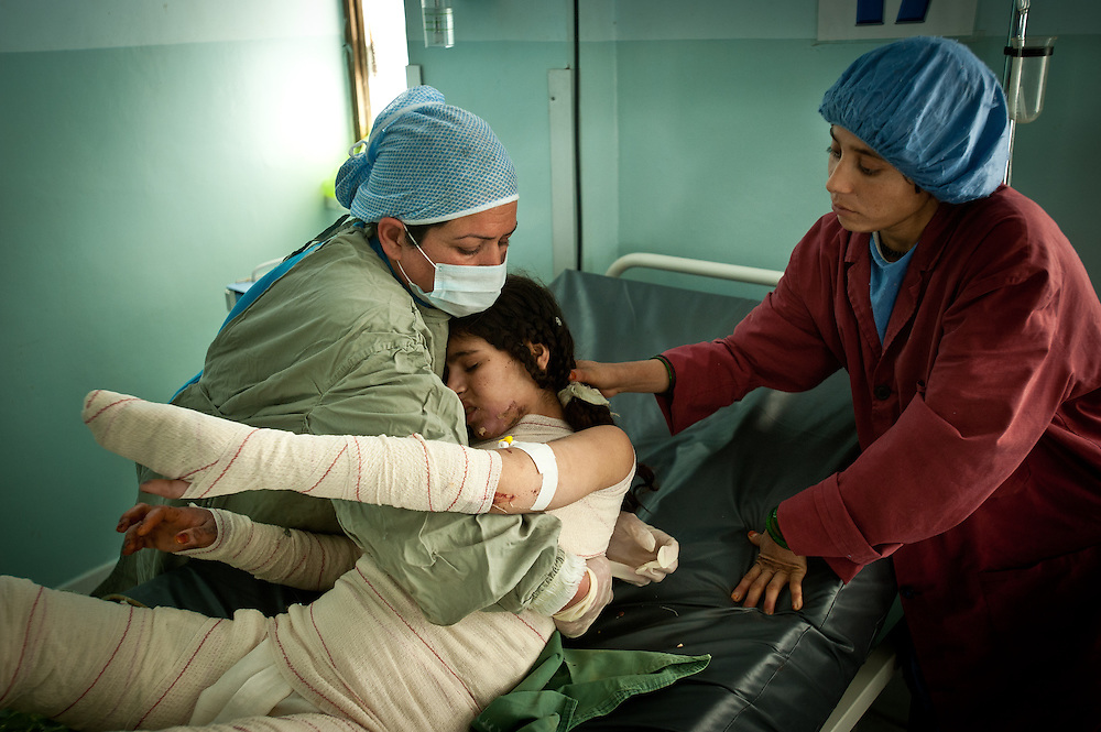 Shayma Amini, left, a nurse in the burn unit at Herat Regional Hospital, changes bandages on a recently admitted burn patient who traveled all the way to Herat from Helmand. Herat Regional Hospital treated 69 self-immolation cases in the first half of 2010 alone.