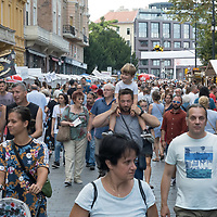 People walk among the booths at the gastronomy festival Street of Hungarian Tastes connected to the national holiday of the state foundation in Budapest, Hungary on Aug. 21, 2021. ATTILA VOLGYI