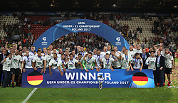 Germany players, coaching staff and officials celebrate winning the UEFA European Under-21 Championship