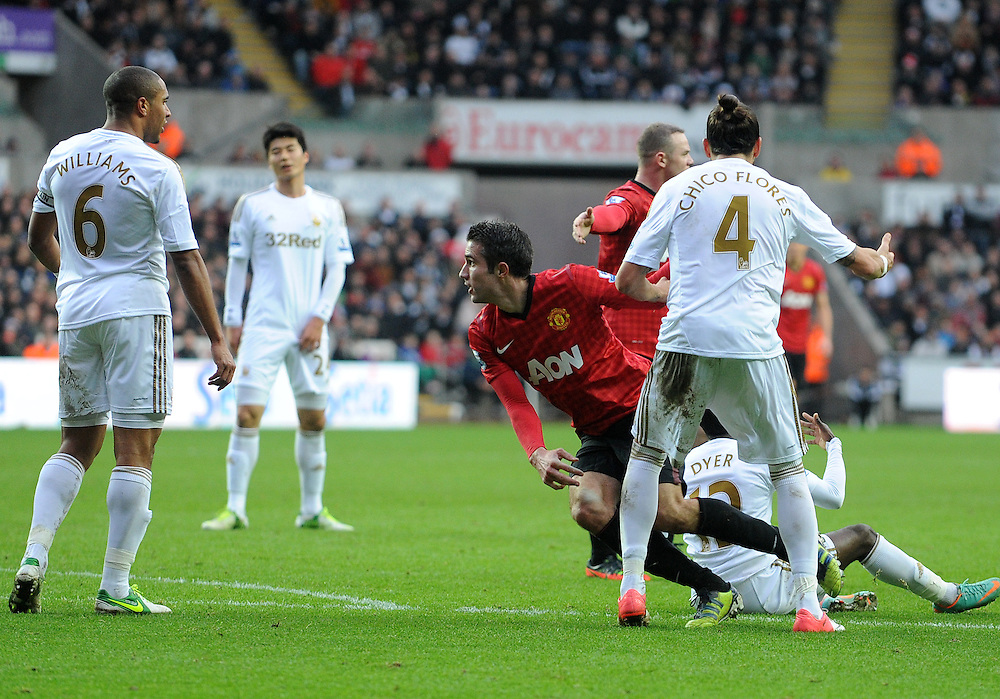Manchester United's Robin van Persie storms after Swansea City's Ashley Williams after Ashley Williams kicked the ball at his head..Football - Barclays Premiership - Swansea City v Manchester United - Sunday 23rd December 2012 - The Liberty Stadium - Swansea..