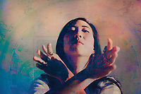 Spiritual woman expressing herself in a yin yand energy mudra.