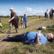The Open Golf Championship at Royal Troon.  A man having a sleep as other spectators notice. Picture Robert Perry 14th July 2016<br /> <br /> Must credit photo to Robert Perry<br /> FEE PAYABLE FOR REPRO USE<br /> FEE PAYABLE FOR ALL INTERNET USE<br /> www.robertperry.co.uk<br /> NB -This image is not to be distributed without the prior consent of the copyright holder.<br /> in using this image you agree to abide by terms and conditions as stated in this caption.<br /> All monies payable to Robert Perry<br /> <br /> (PLEASE DO NOT REMOVE THIS CAPTION)<br /> This image is intended for Editorial use (e.g. news). Any commercial or promotional use requires additional clearance. <br /> Copyright 2014 All rights protected.<br /> first use only<br /> contact details<br /> Robert Perry     <br /> 07702 631 477<br /> robertperryphotos@gmail.com<br /> no internet usage without prior consent.         <br /> Robert Perry reserves the right to pursue unauthorised use of this image . If you violate my intellectual property you may be liable for  damages, loss of income, and profits you derive from the use of this image.