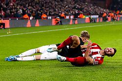 George Baldock of Sheffield United is fouled by Brandon Williams of Manchester United - Mandatory by-line: Robbie Stephenson/JMP - 24/11/2019 - FOOTBALL - Bramall Lane - Sheffield, England - Sheffield United v Manchester United - Premier League