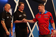 Caller Russ Bray congratulates Daryl Gurney during the Darts World Championship 2018 at Alexandra Palace, London, United Kingdom on 18 December 2018.