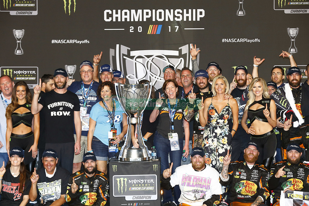 November 19, 2017 - Homestead, Florida, United States of America - November 19, 2017 - Homestead, Florida, USA: Martin Truex Jr (78) takes the checkered flag and wins the 2017 Monster Energy NASCAR Cup Championship during the Ford EcoBoost 400 at Homestead-Miami Speedway in Homestead, Florida. (Credit Image: © Justin R. Noe Asp Inc/ASP via ZUMA Wire)