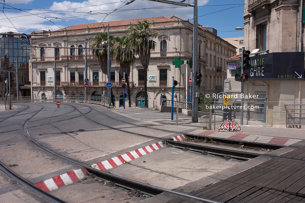 A junction of tracks and roadways on the high overpass of the L1 and L3 tram routes at Gare Saint-Roch in Montpellier, south of France.