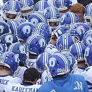 Darien players prepare for the second half during the New Canaan Rams Vs Darien Blue Wave, CIAC Football Championship Class L Final at Boyle Stadium, Stamford. The New Canaan Rams won the match in snowy conditions 44-12. Stamford,  Connecticut, USA. 14th December 2013. Photo Tim Clayton