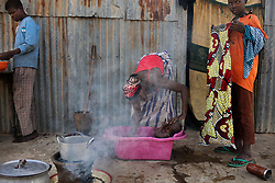 Aisha, 17, washes her 8-month-old son Mohammed, born of a Boko Haram fighter. Five girls from her family were taken by the militant Islamist group, which began it's insurgency against the Nigerian government in 2009. The terrorist group drew global outrage after abducting more than 270 schoolgirls from the town of Chibok. Many of the girls were forced into marriage and motherhood. The Borno State National Emergency Agency estimates tens of thousands more women and girls have also been kidnapped by militants in less-publicized attacks. In armed conflicts, child marriage is increasingly used as a weapon of war, forcing girls to give birth give birth to the next germination of fighters. Thousands of girls remain missing in Nigeria with little help of rescue. Those who manage to escape struggle with little support to rebuild their lives.