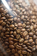 Coffee beans sit inside a grinder during the 2nd Annual Mock Barista Competition and Brewer's Cup at San Pedro Square Market in San Jose, California, on February 21, 2013.  (Stan Olszewski/SOSKIphoto)