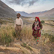 Husband and wife doing field work. The life of the Wakhi people, in the Wakhan corridor, amongst the Pamir mountains. Trekking with Paul Salopek.