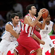 Olympiacos's Dimitruios KATSIVELIS (R) during their Two Nations Cup basketball match Anadolu Efes between Olympiacos at Abdi Ipekci Arena in Istanbul Turkey on Sunday 02 October 2011. Photo by TURKPIX