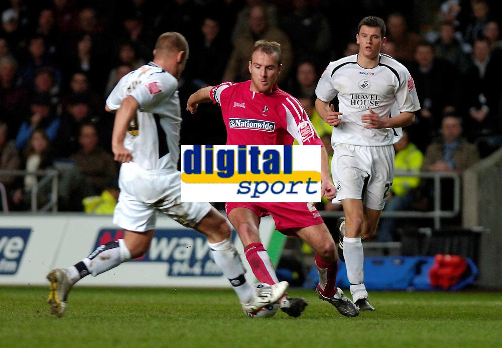 Photo: Adam Davies.<br /> Swansea City v Swindon Town. Coca Cola League 1. 11/04/2006.<br /> Swindon's Sean O;Hanlon is tackled by Swansea's Andy Robinson.